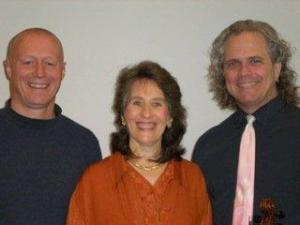 3 smiling faces: John, Liz and Scott after a concert